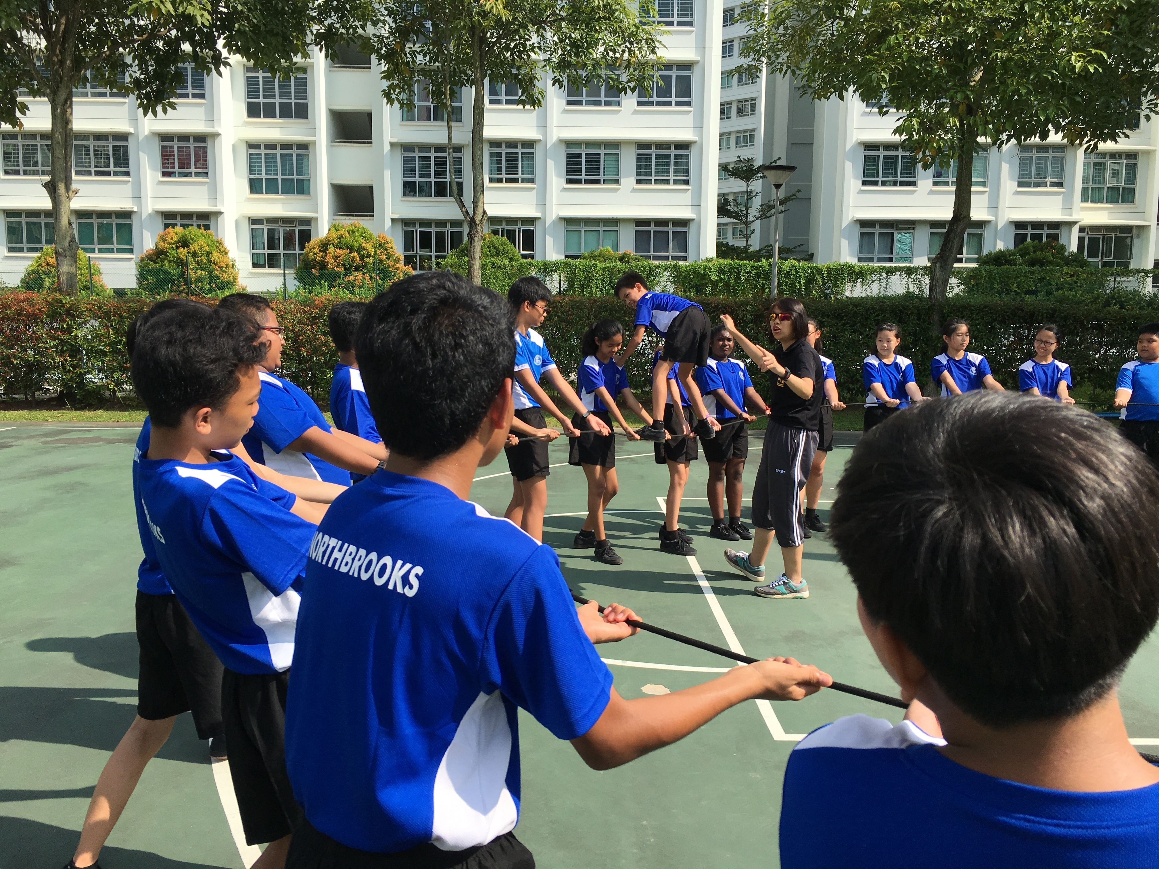 By the power of teamwork, Sec 1s learn to keep their friend up in the air.JPG